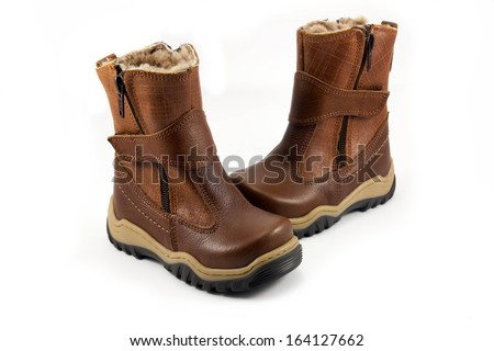 Children's winter shoes isolated over the white background