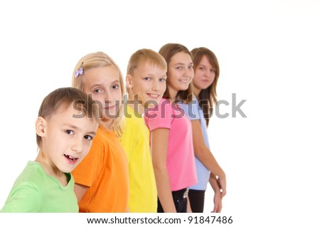 Children stand in a row on a white background - stock photo