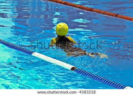 Children swimming competition, in the  pool