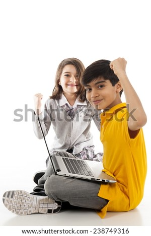 children using a laptop over white background. - stock photo