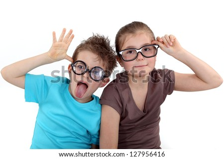 Children wearing funky glasses - stock photo