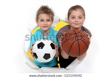 Children with a football and basketball - stock photo