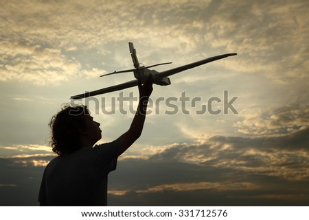 children with airplan toy outdoors - stock photo
