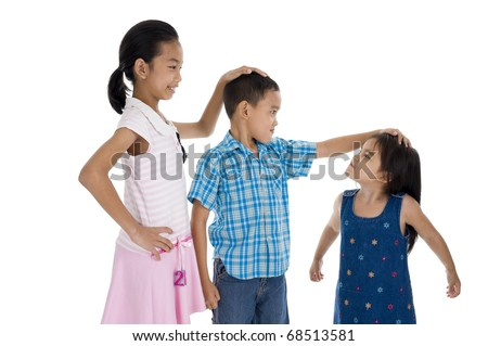 children with different sizes, isolated on white background - stock photo
