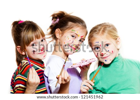 Children with painted faces and hands