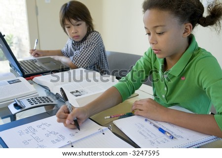 Children working on homework at a table