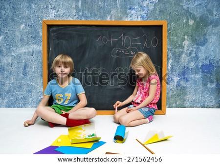 Children write on the blackboard - stock photo