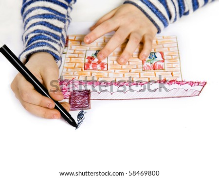 Childrens hand with pencil draws the house , isolated on white background - stock photo