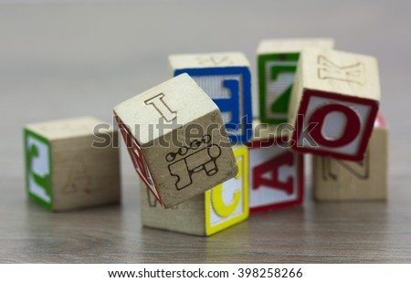 Childrens play blocks on a wooden floor