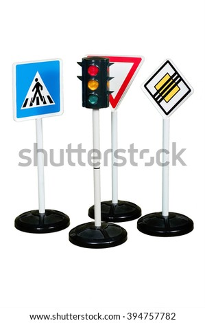 Childrens road signs and traffic light on white background - stock photo
