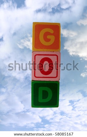 childrens toy letter building blocks against a cloudy background spelling god with clipping path - stock photo