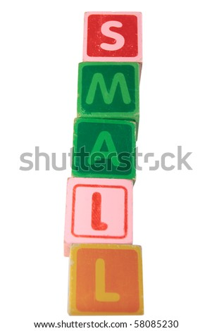 childrens toy letter building blocks against a white background spelling small
