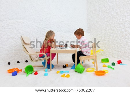 Childs play in salt room. Halotherapy for treatment of respiratory diseases. - stock photo