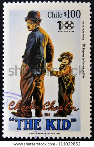 CHILE - CIRCA 1995: A stamp printed in Chile shows Charles Chaplin in The Kid, circa 1995 - stock photo