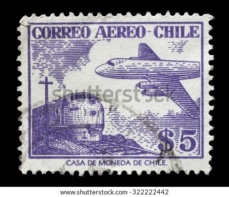 CHILE - CIRCA 1950s: A stamp printed in Chile shows plane on the background of trane, circa 1950s - stock photo