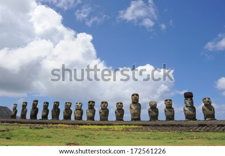 CHILE - FEBRUARY 6: Moai sit on Easter Island on February 6, 2012. The giant monuments were carved from volcanic stone and face away from the mythical spirit world of the sea. - stock photo