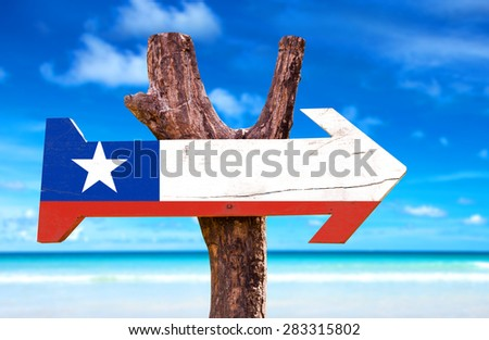 Chile Flag wooden sign with beach background - stock photo