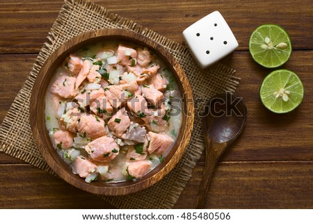 Chilean salmon ceviche prepared with onion, garlic, fresh coriander, salt and lemon juice, photographed overhead with natural light (Selective Focus, Focus on the top of the ceviche)