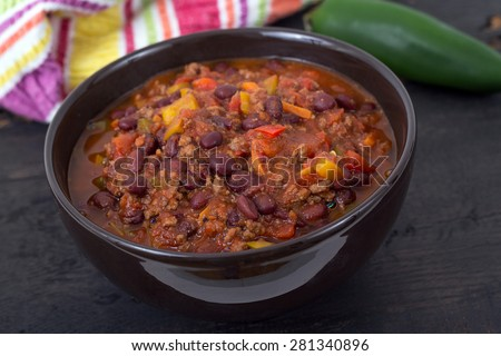 chili con carne beef chili on black table - stock photo