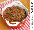Chili con carne in casserole dish. - stock photo