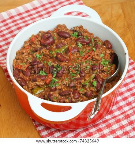 Chili con carne in casserole dish. - stock photo