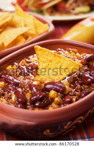 Chili con carne served with corn tacos - stock photo