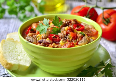 Chili con carne - traditional dish of mexican cuisine. - stock photo