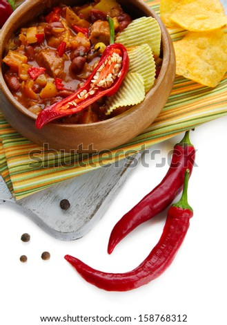 Chili Corn Carne - traditional mexican food, in wooden bowl, on napkin, isolated on white - stock photo