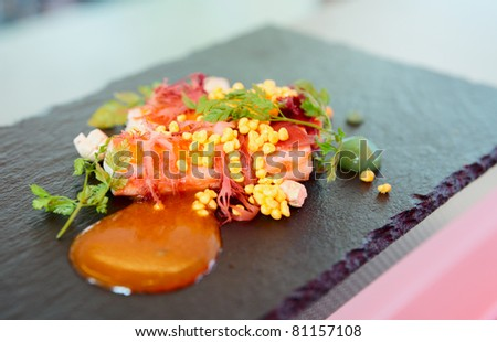 Chili crab cooked in modern way with molecular egg yolk caviar - stock photo