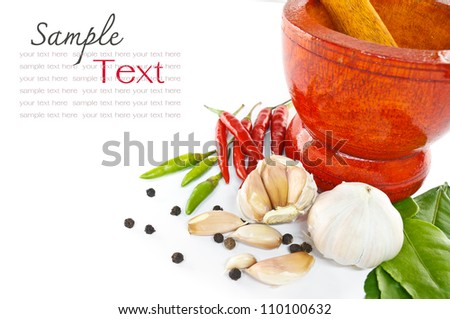Chili ,garlic, pepper and  kaffir lime leaves)  with wooden mortar - stock photo