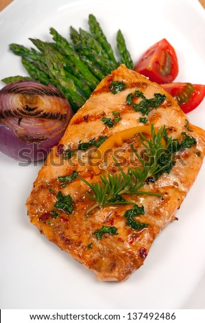 Chili pepper marinated grilled salmon, asparagus - stock photo