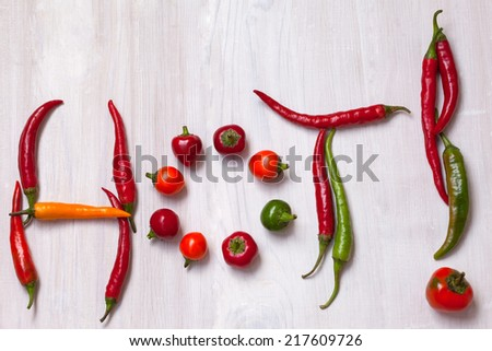 """Chili peppers make word """"hot"""" - stock photo"""