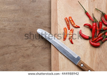chili peppers on a kitchen cutting board - stock photo