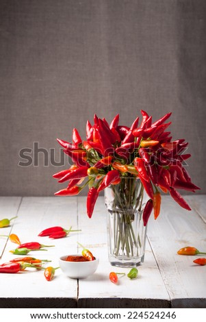 Chili peppers on a white wooden background - stock photo