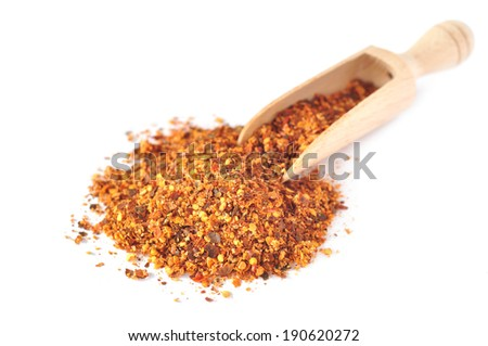 Chili powder in a wooden scoop. - stock photo