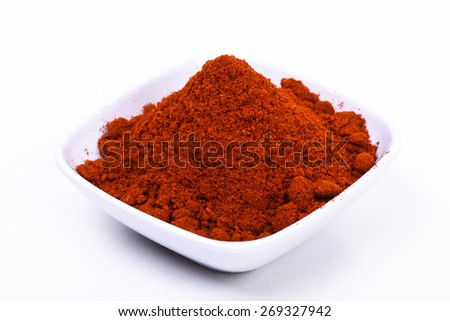 chili powder on a white background. image suitable for food products, restaurants, fresh goods store, wholesaler and seller of the product chilies or chili based health products - stock photo