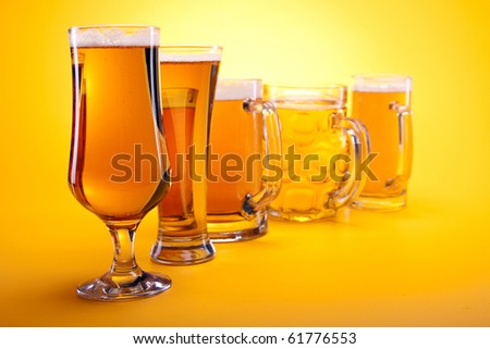 Chilled beer on yellow background