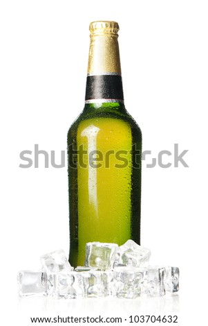 Chilled bottle of beer, surrounded by ice cubes - stock photo
