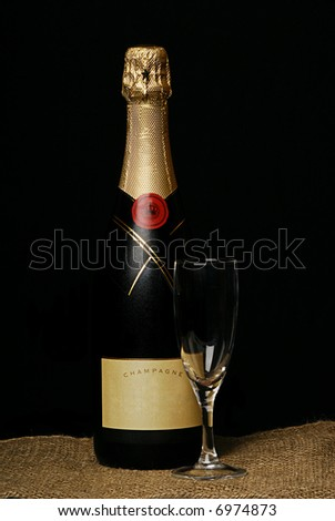 chilled bottle of champaign on black - stock photo