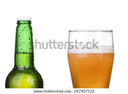 Chilled green bottle with condensation and a glass of beer lager on Isolated white background - stock photo