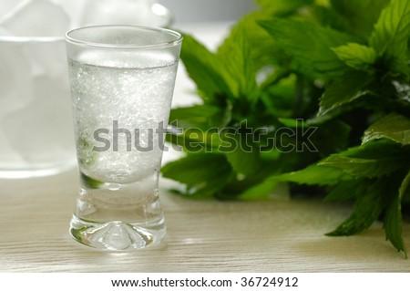 Chilled mastika alcohol with aniseed flavour (tastes like greek ouzo) - stock photo