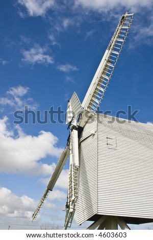 Chillenden Post Mill, in Kent, under cloudy and blue skies.Built in 1868 probably one of the last windmills built in Kent. Destroyed after Storms and reconstructed with National Lottery funding - stock photo