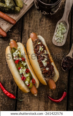 Chilli and vegetarian hot dog, home pickles, beef meat and homemade barbeque souce - stock photo