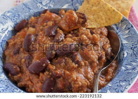 Chilli con Carne served with tortilla chips - stock photo