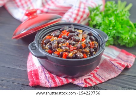 Chilli con carne with red pepper and black beans - stock photo