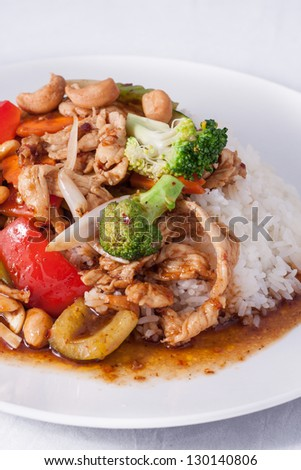 chilli jam chicken cashew nuts with rice. - stock photo