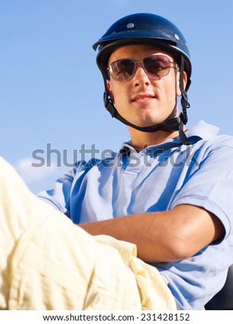 Chilling on scooter - stock photo