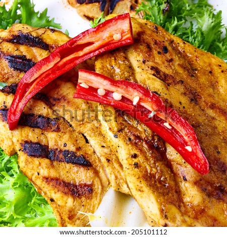 Chilly chicken BBQ on Roca-Loca salad. Hot, spicy and fire second course. - stock photo