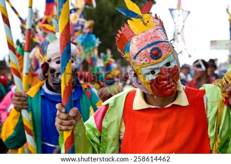 CHIMBORAZO, ECUADOR - JUNE 20, 2010: Unidentified dancer with elaborate costume at Inti Raymi indigenous celebration in Chimborazo province, Ecuador - stock photo