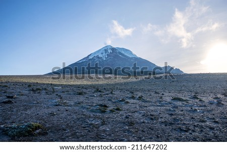 Chimborazo volcano at dawn on a sunny day - stock photo